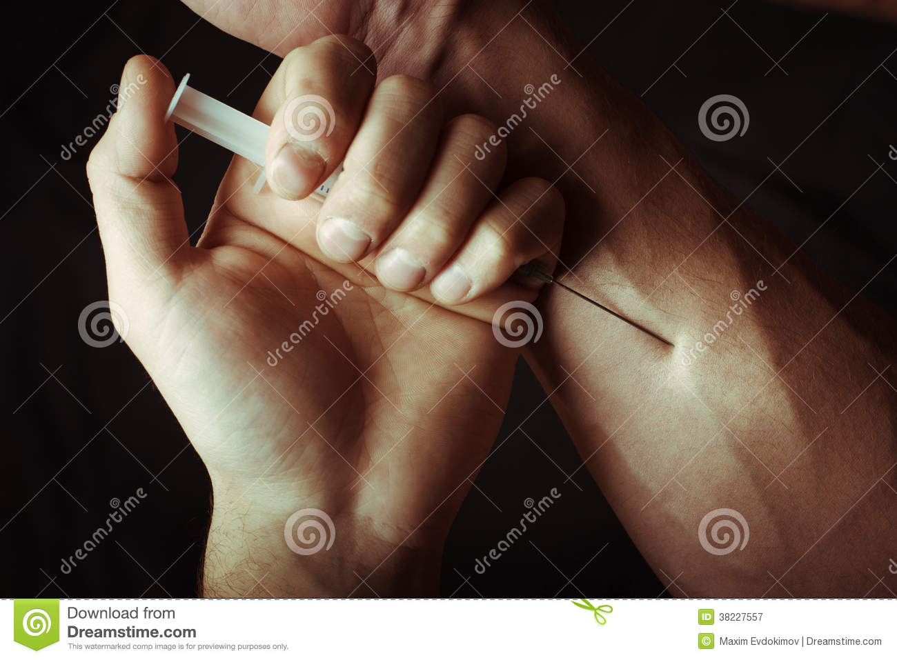 Hand with heroin syringe