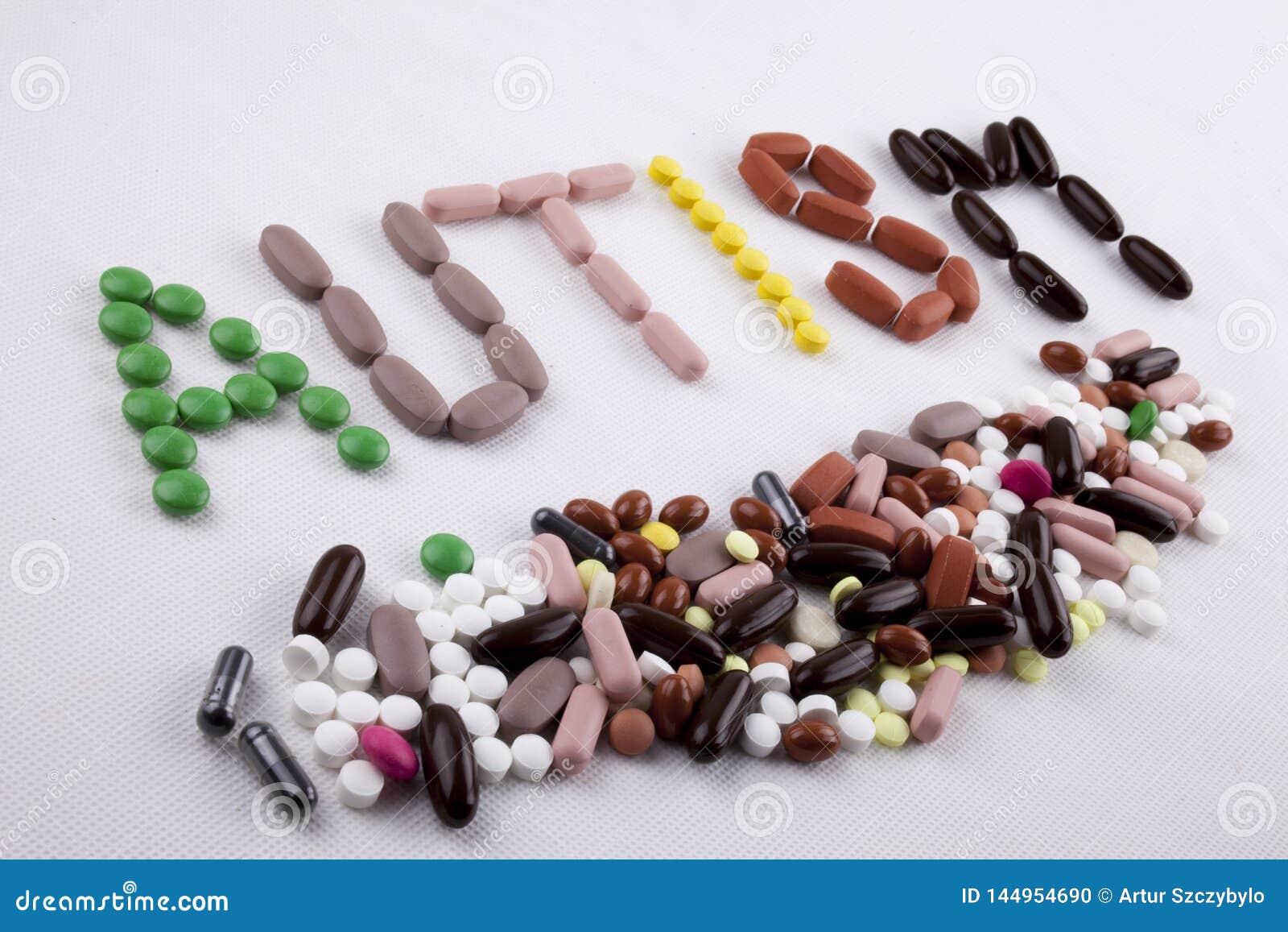 Hand het schrijven het concept van de de inspiratiemedische behandeling van de teksttitel met het AUTISME van het de capsulewoord