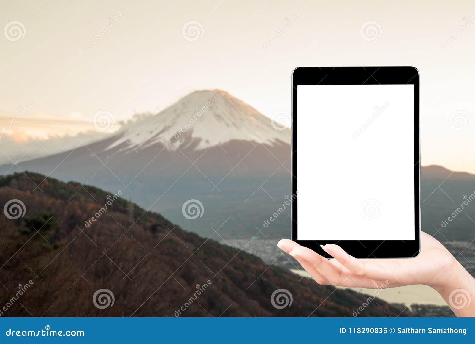 In hand het touche screen neemt een berg van fotofuji