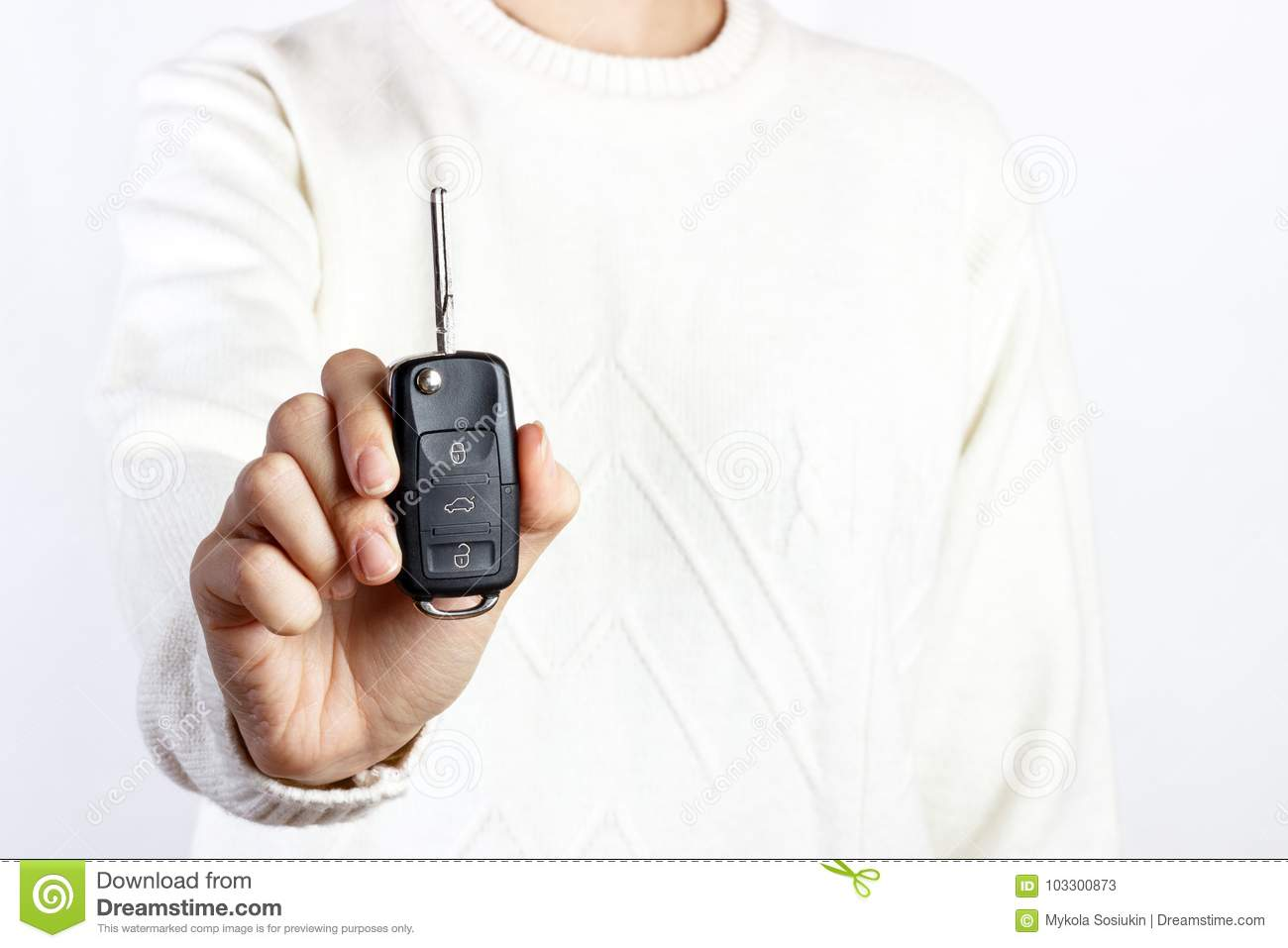 hand hold car key on white backgrounds