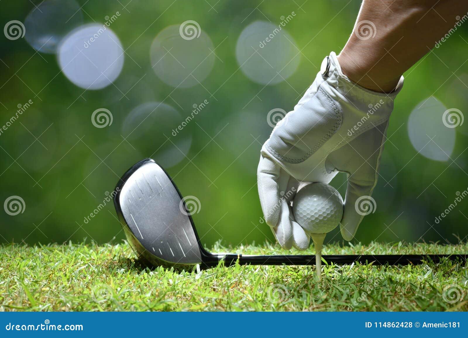 Hand hold golf ball with tee