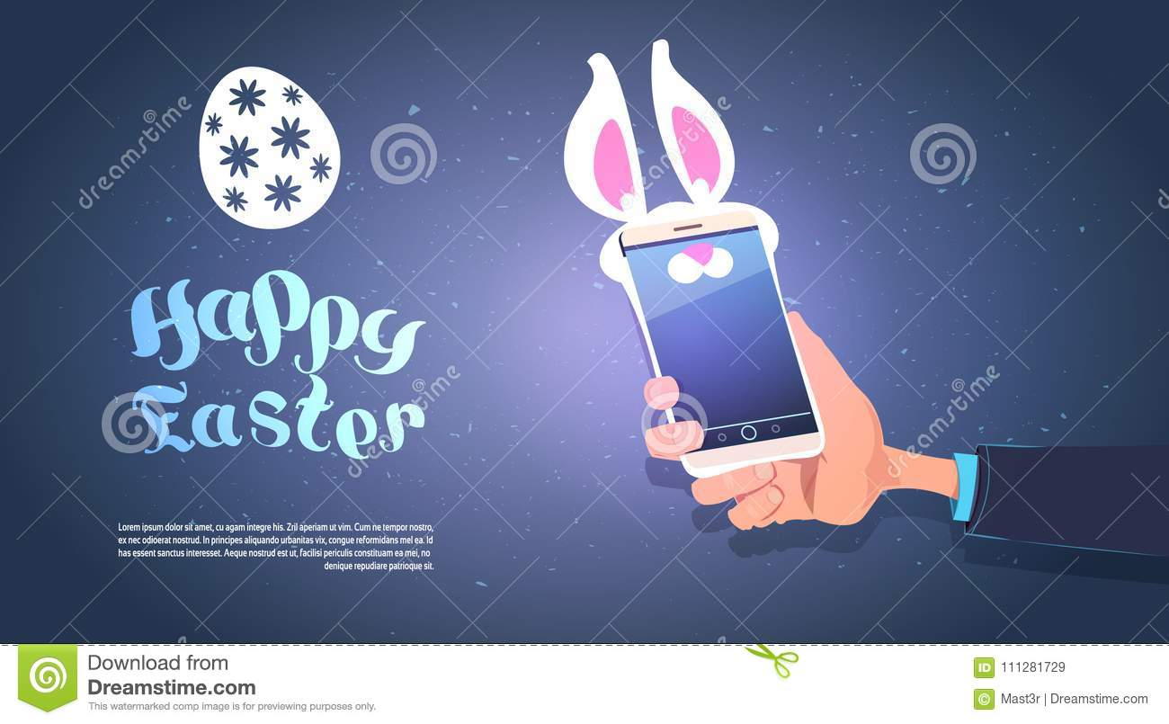 Hand Hold Smart Phone With Bunny Ears Happy Easter Background With Copy Space