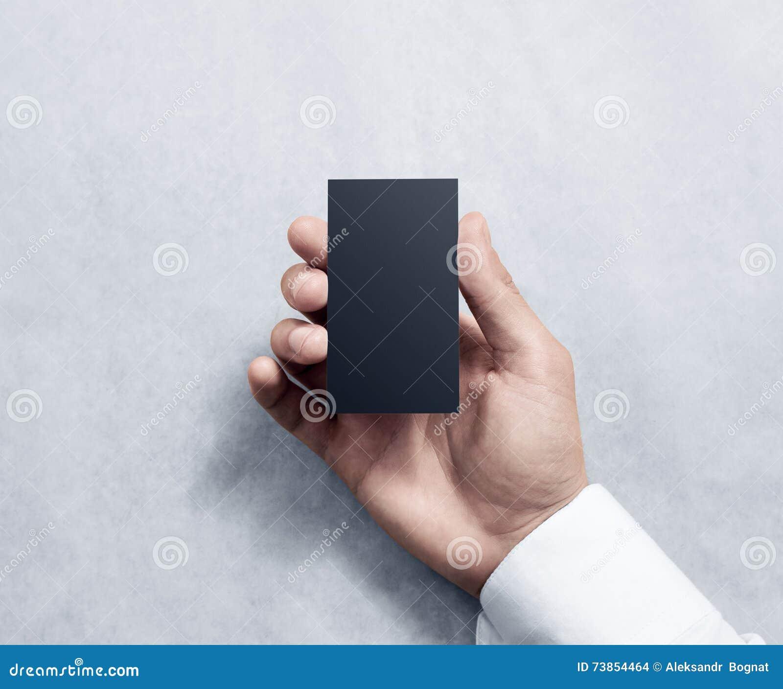 Hand Holding Blank Vertical Black Business Card Design Mockup Stock