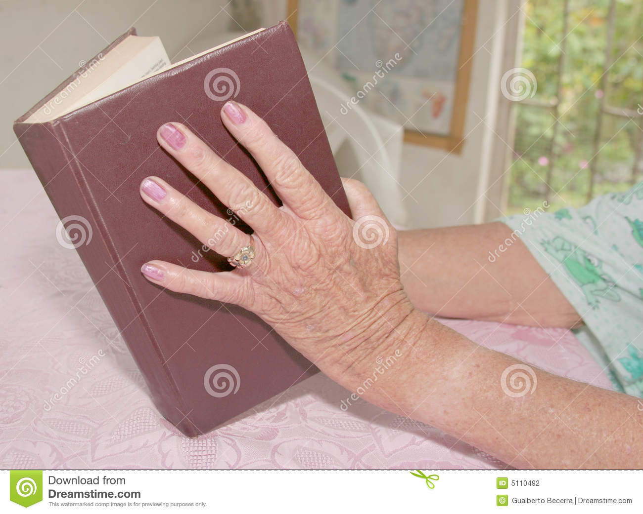 hand holding a book stock photography