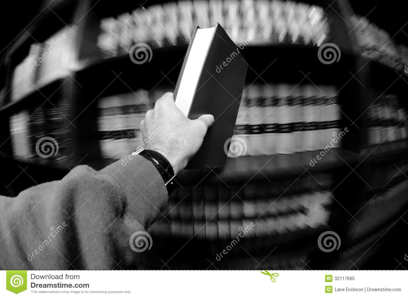 Hand Holding Book in Library