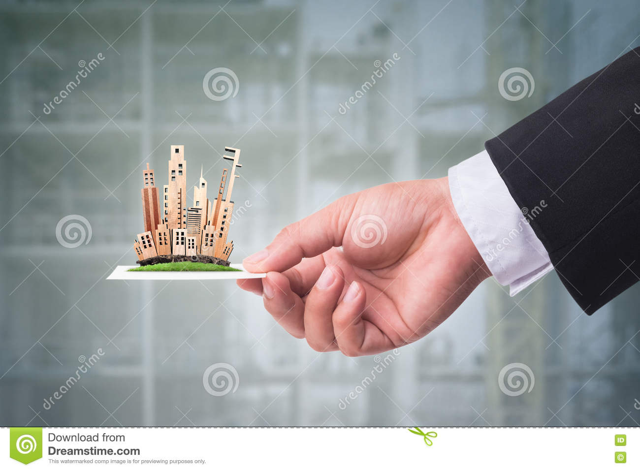 Hand Holding Business Card With Miniature Building Model. Real E ...