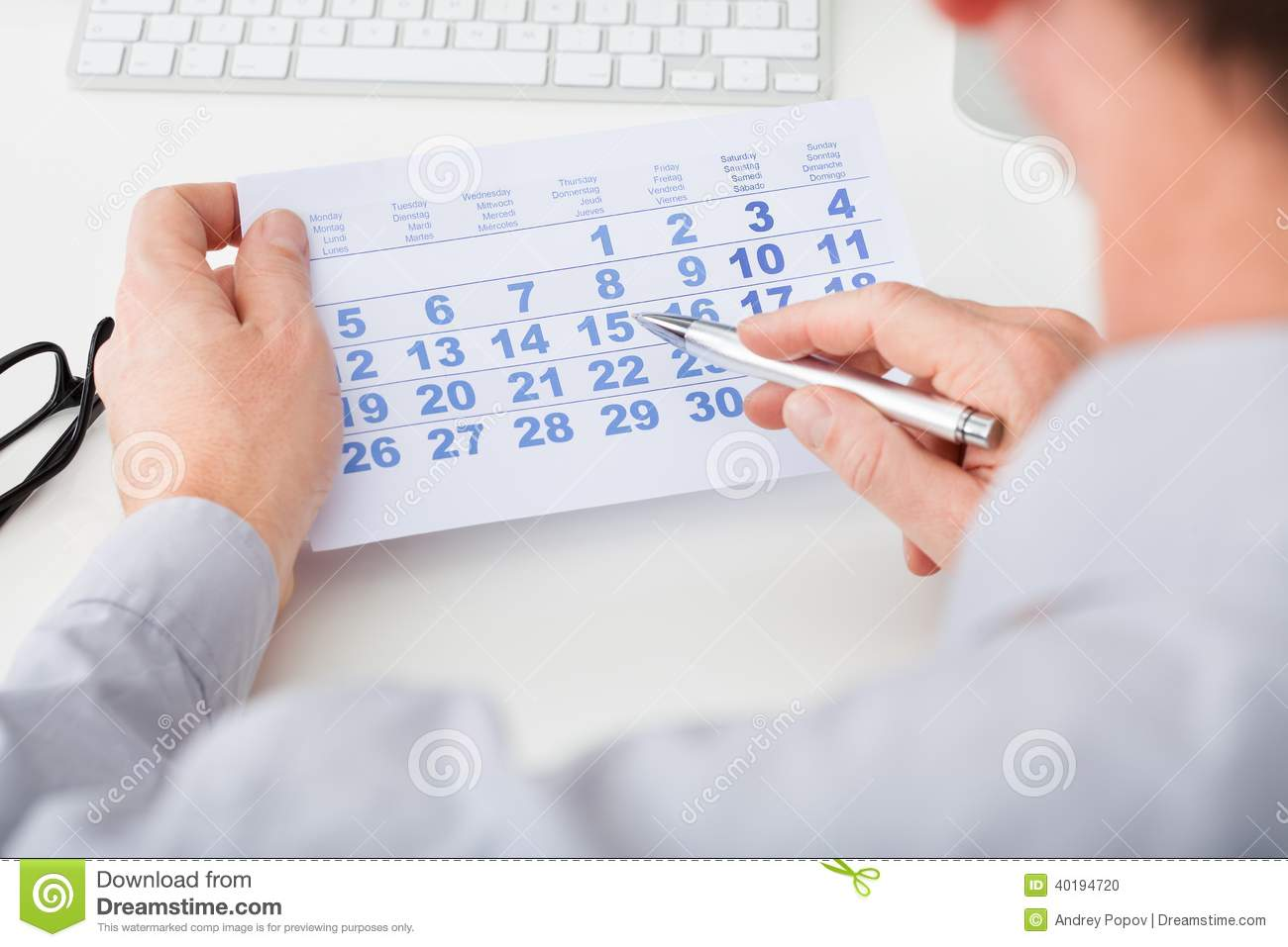 Calendar Photography Jobs : Hand holding calendar and pen stock photo image of