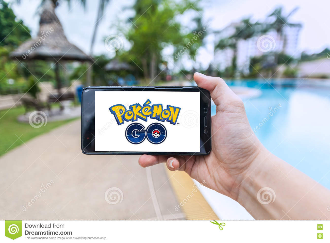 Hand Holding A Cellphone Playing Pokemon Go Editorial Photo Image Of Connect Hand 74840701