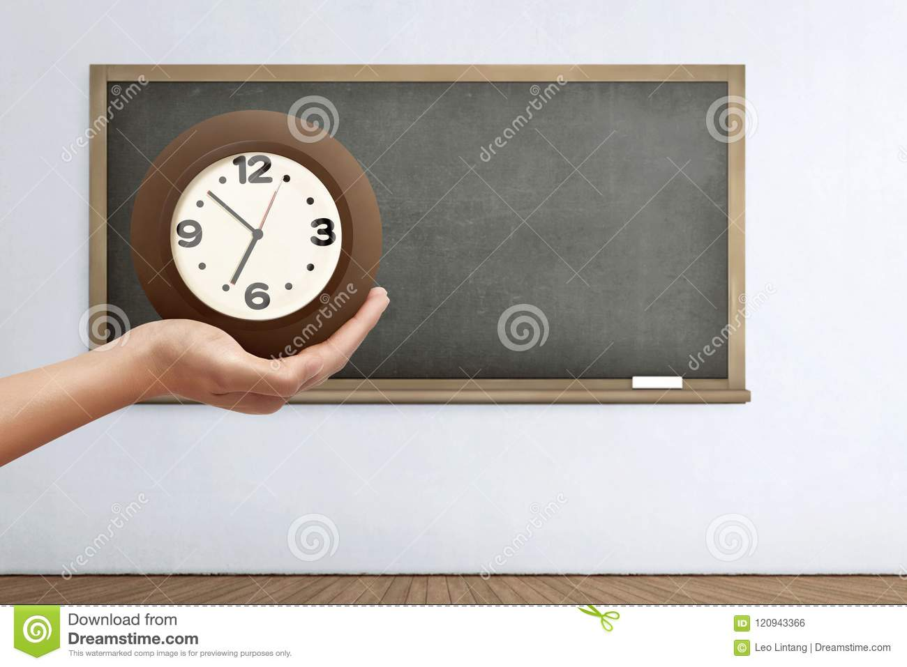 Hand holding the clock
