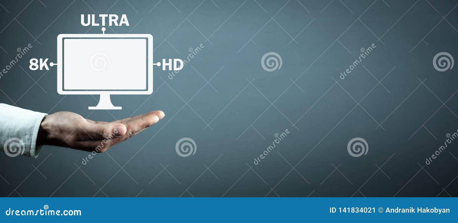 Hand holding computer monitor. 8K Ultra HD. Digital Video Technology