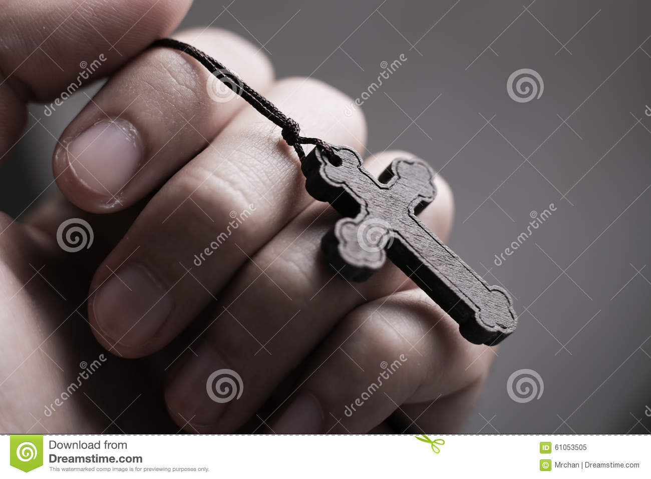 6909b13ab Closeup of praying hand holding the wooden cross. More similar stock images