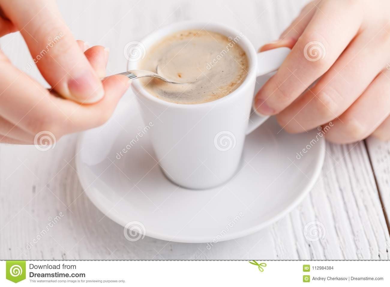Hand holding a cup of coffee