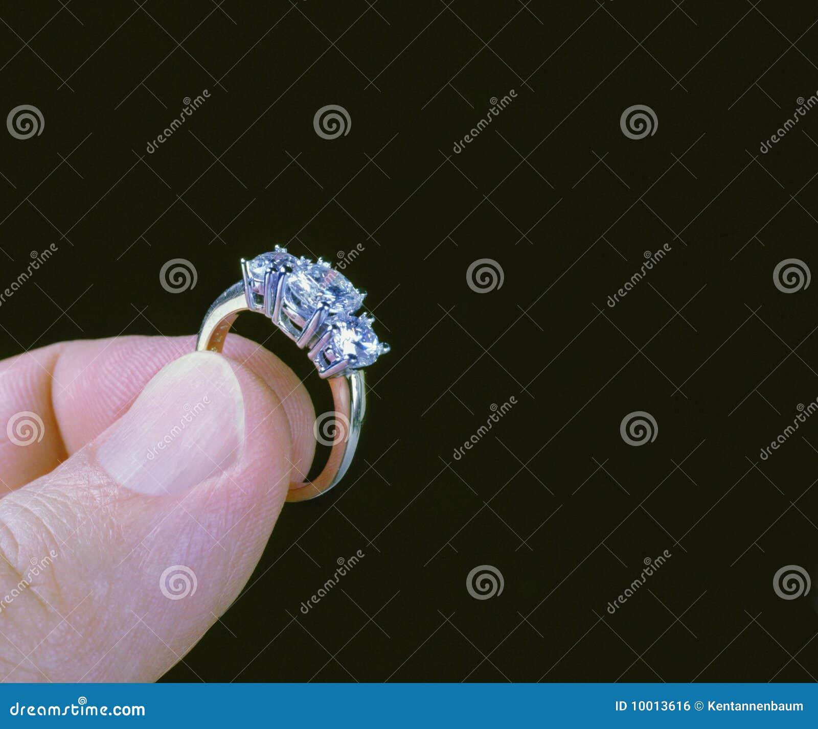 Hand holding diamond ring