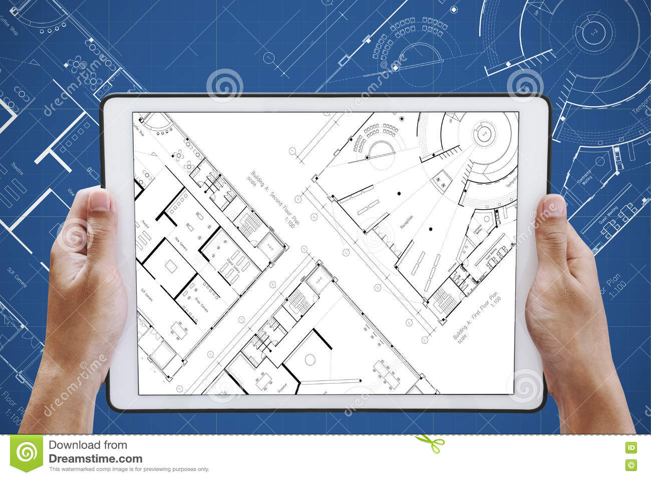 Hand holding digital tablet with architectural planning on screen royalty free stock photo malvernweather Choice Image
