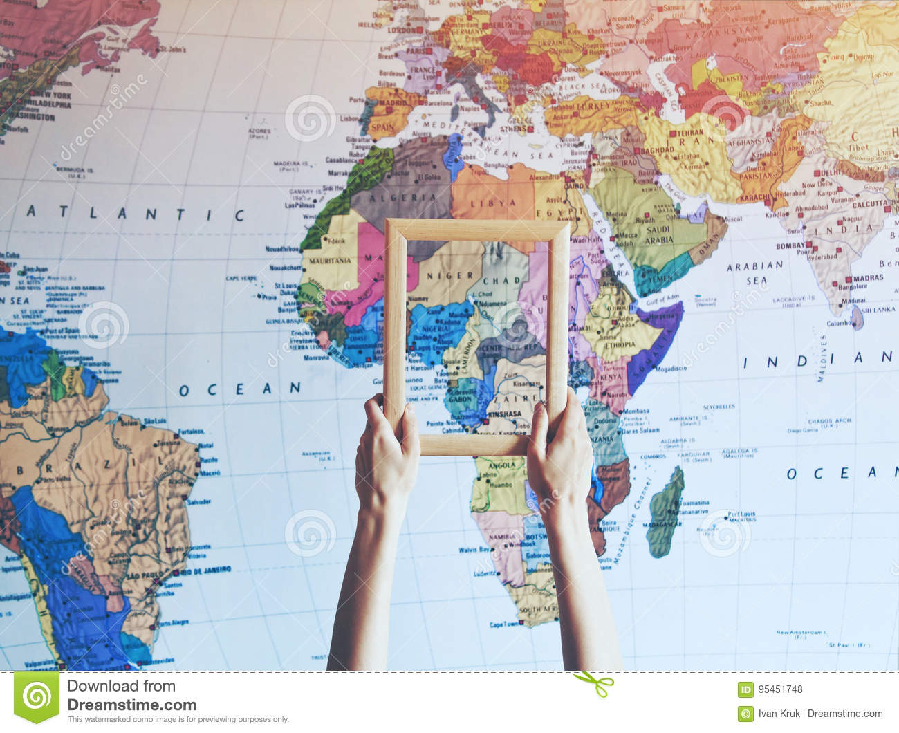 Hand Holding Empty Wooden Frame On Africa Map Stock Photo - Image of ...