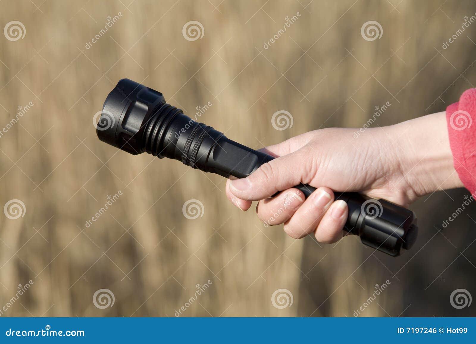 Hand holding a flashlight