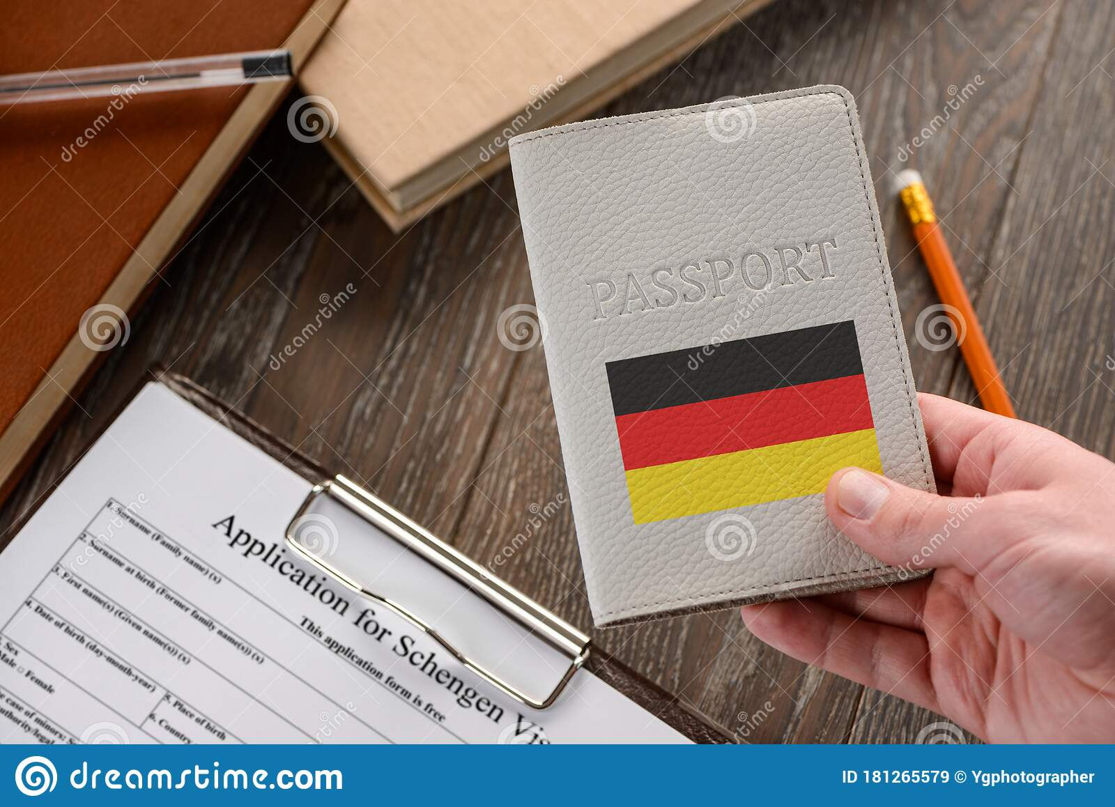 Hand Holding A German Passport An Application Form In Background Stock Image Image Of Identity German 181265579