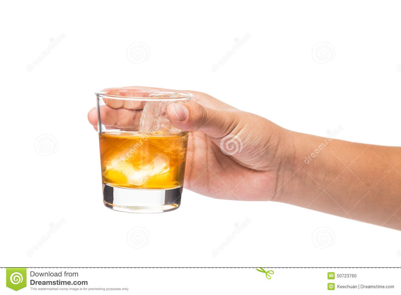 hand holding a glass of whiskey on the rocks stock photo. Black Bedroom Furniture Sets. Home Design Ideas