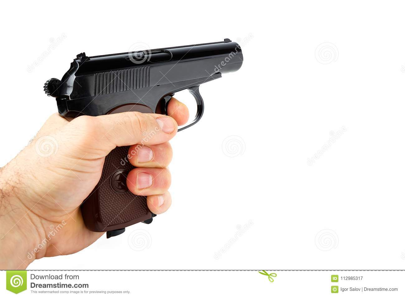 Hand holds a gun isolated on white background