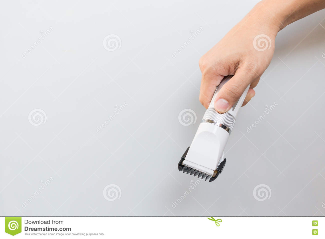 Hand Holding Hair Clippers Stock Photography