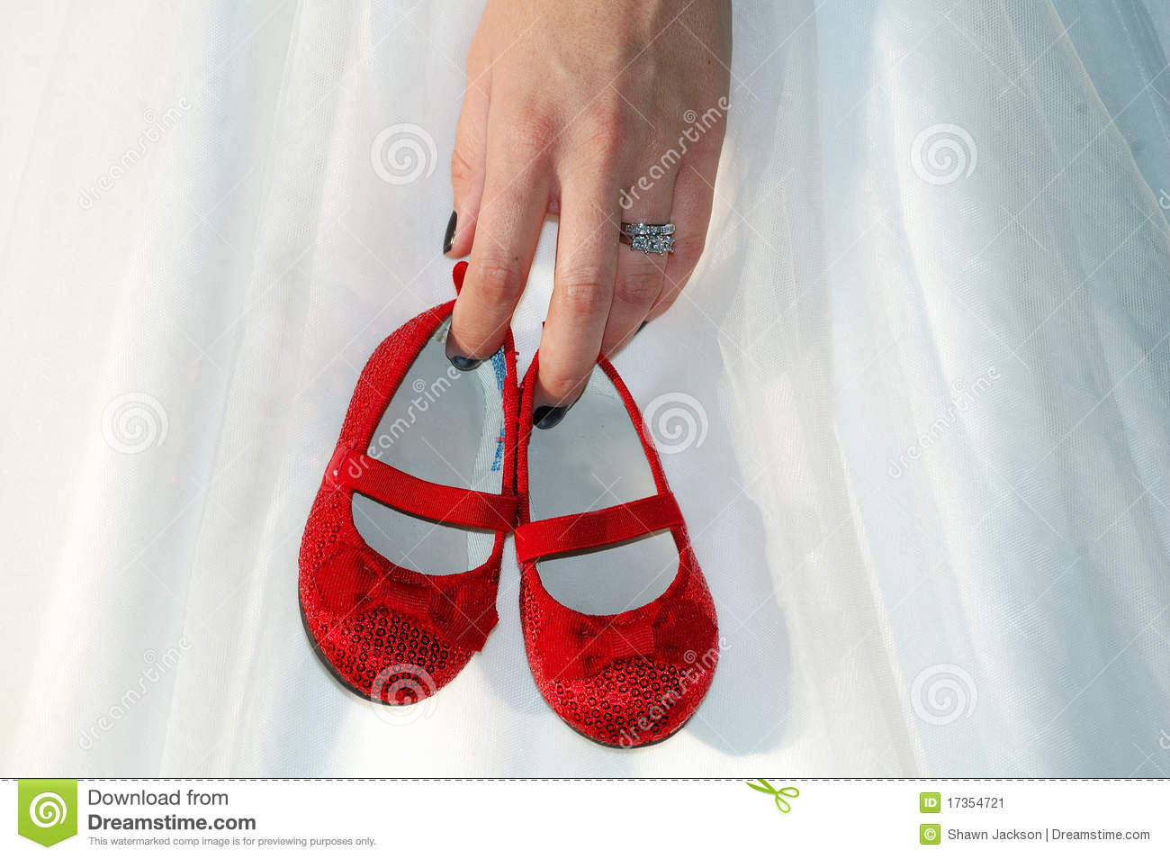 Hand Holding Little Red Shoes Stock Image - Image: 17354721