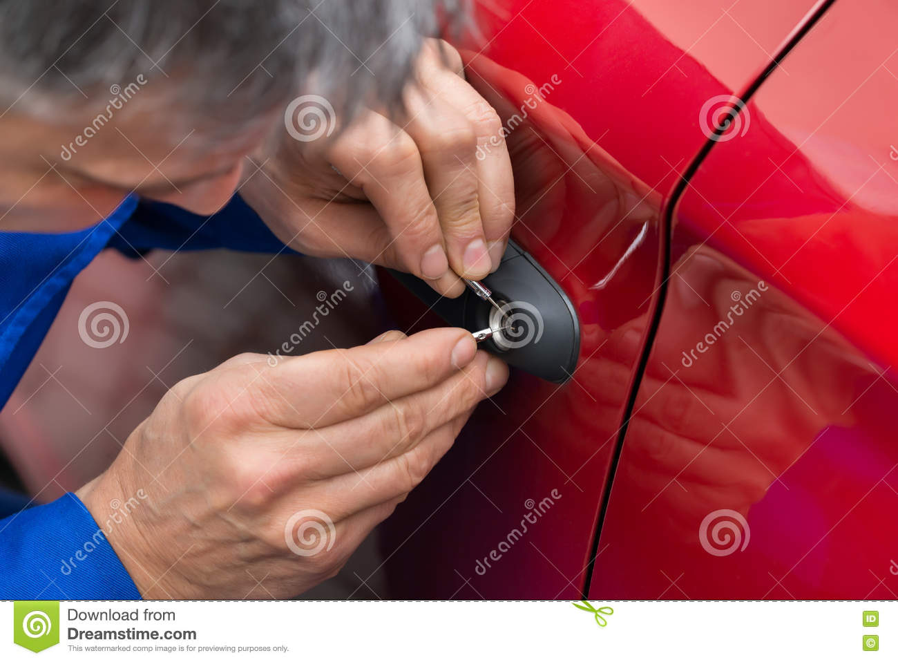Hand Holding Lockpicker To Open Car Door Stock Photo