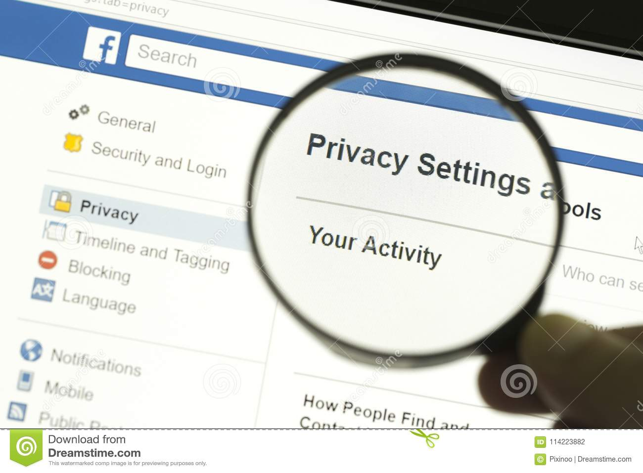 Hand holding a magnifying glass and magnifying the word Privacy settings