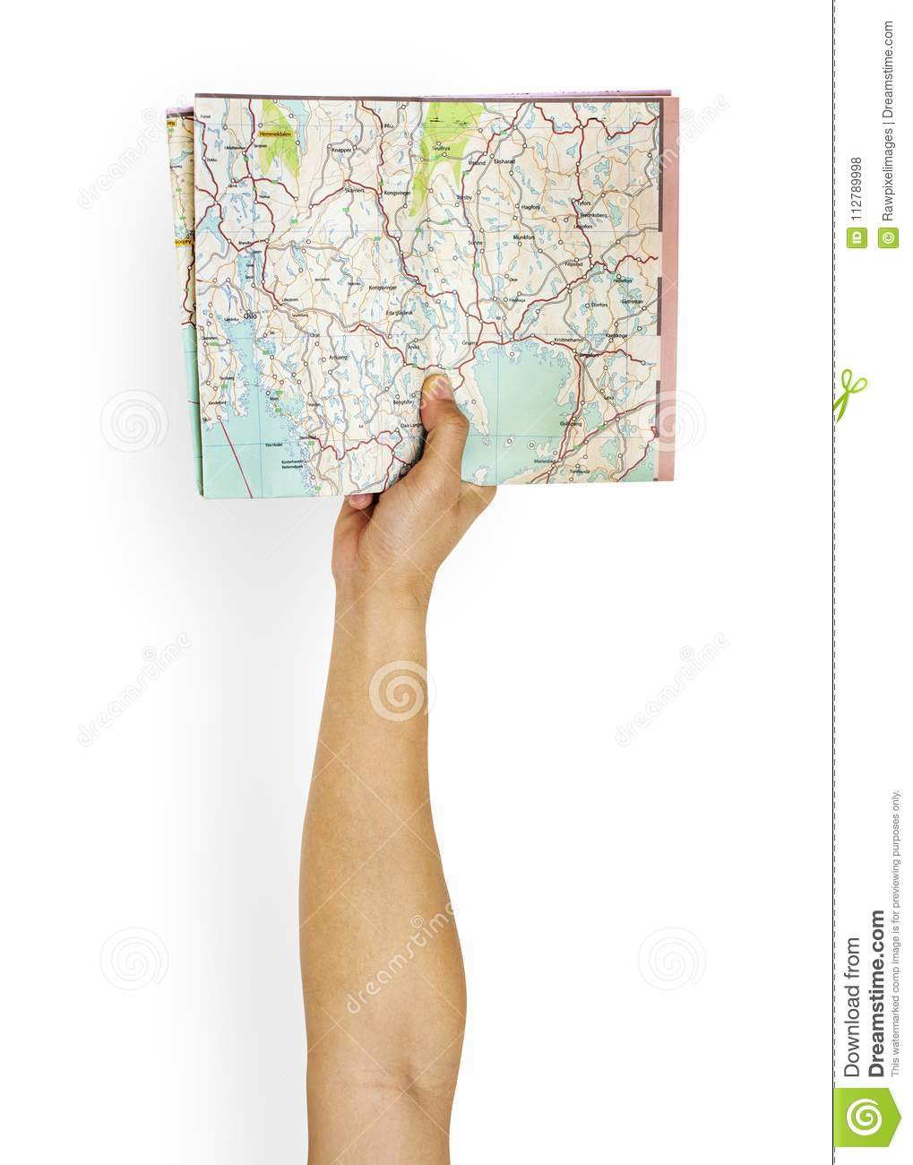 Hand holding a map for directions