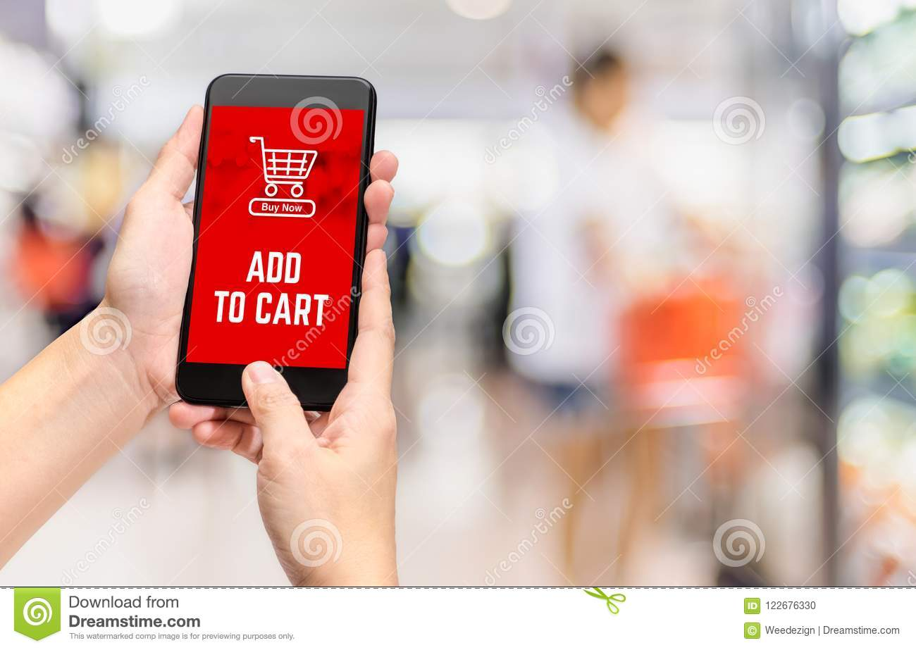 Hand holding mobile add to cart product to purchase online with