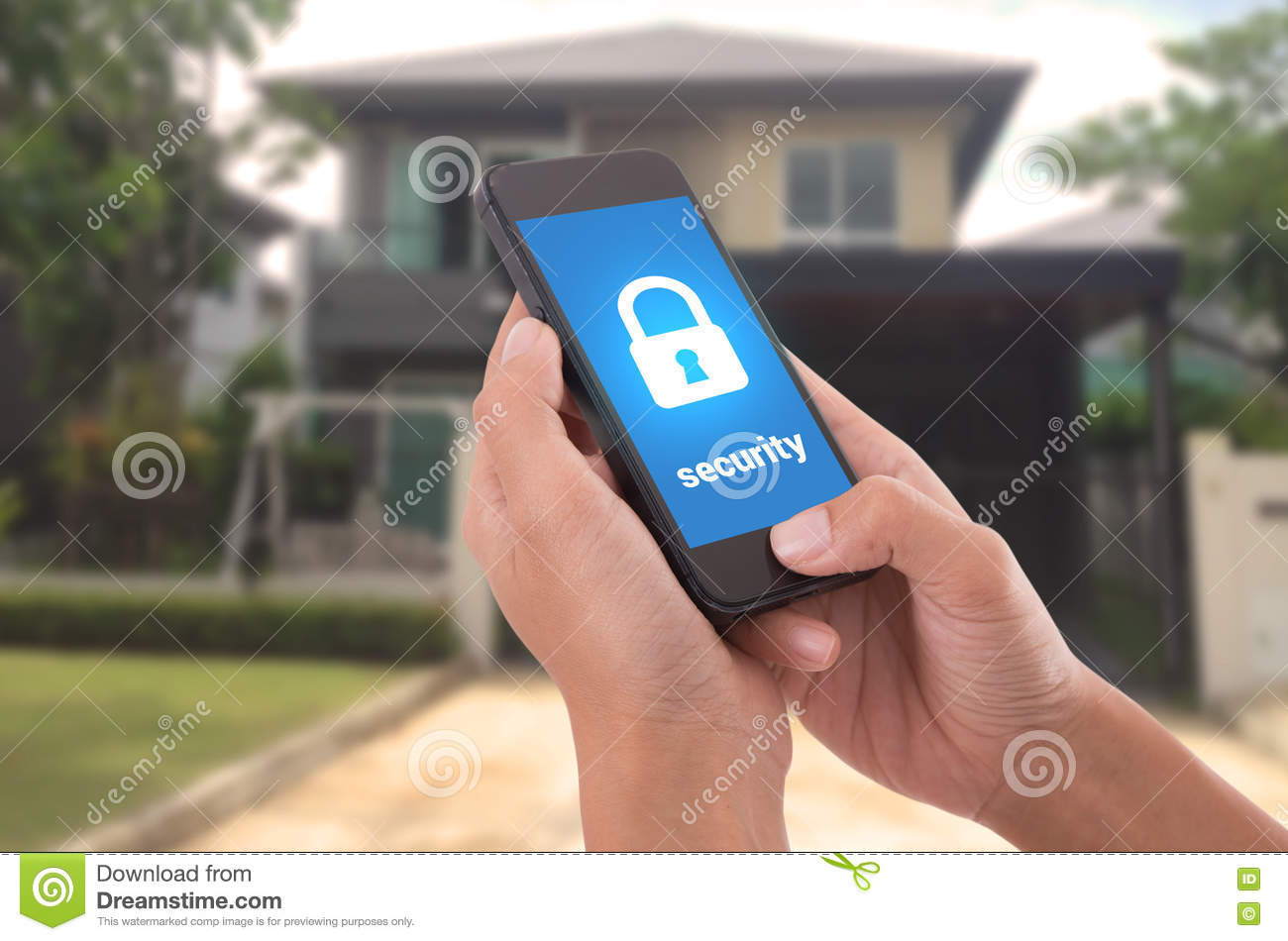 Hand holding mobile phone with concept technology home security