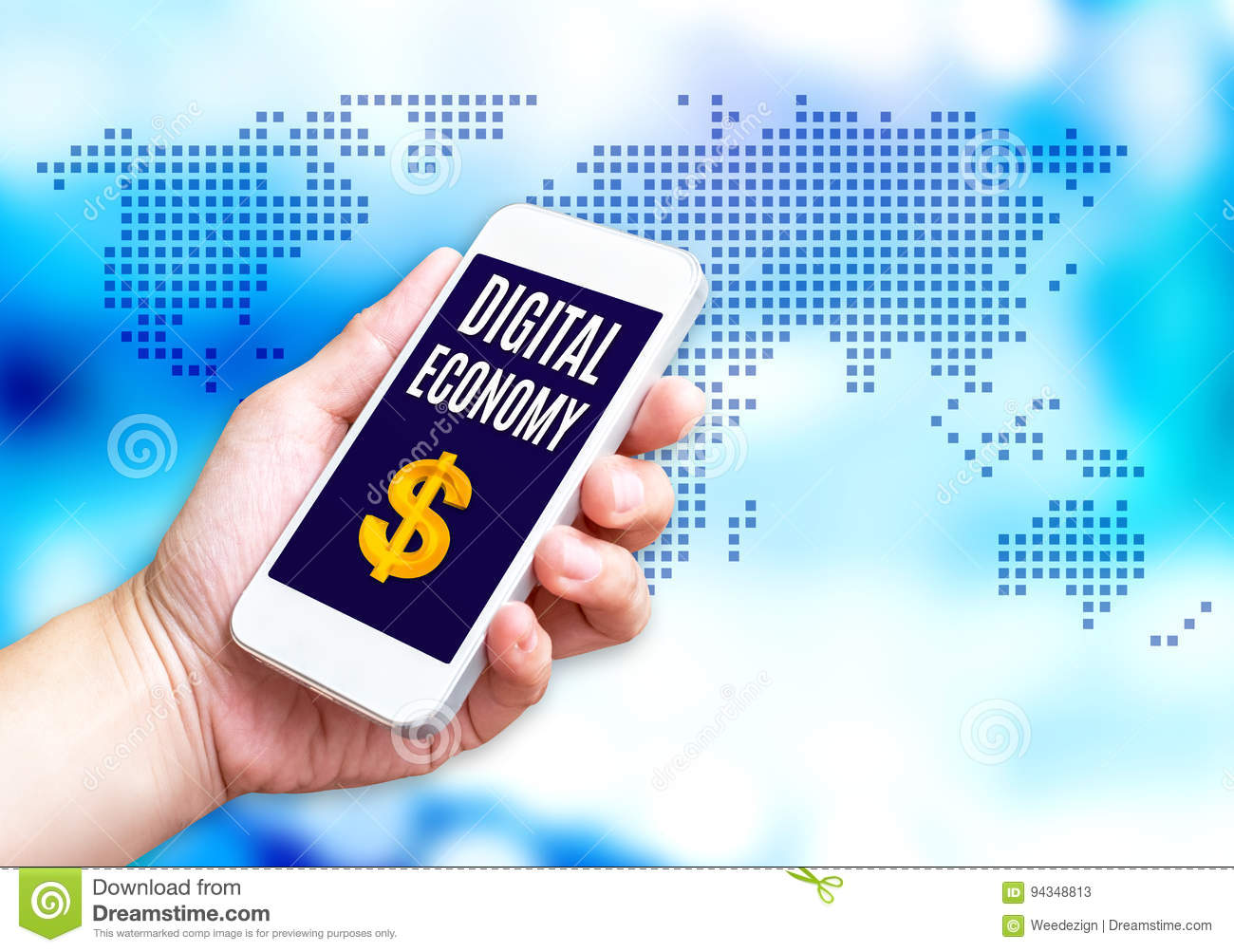 Hand holding mobile phone with Digital economy word with blue bl