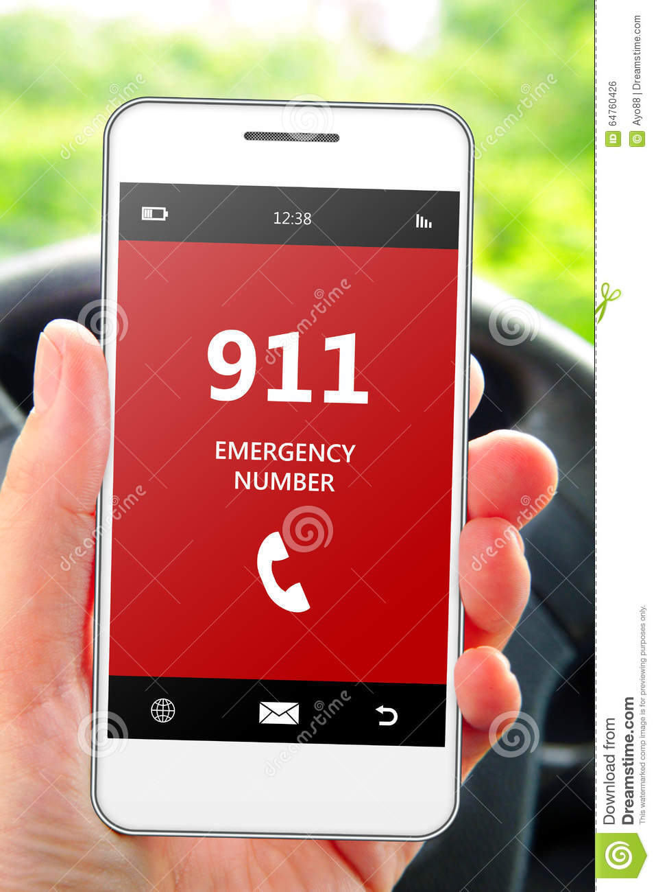 Hand holding mobile phone 911 emergency number in car
