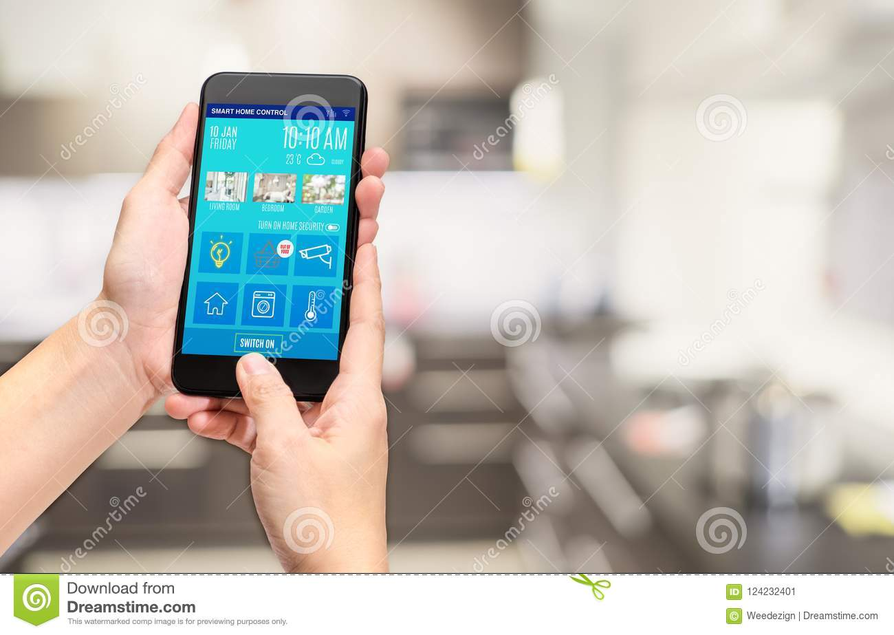 Hand holding mobile use smart home control mobile app at blur bo