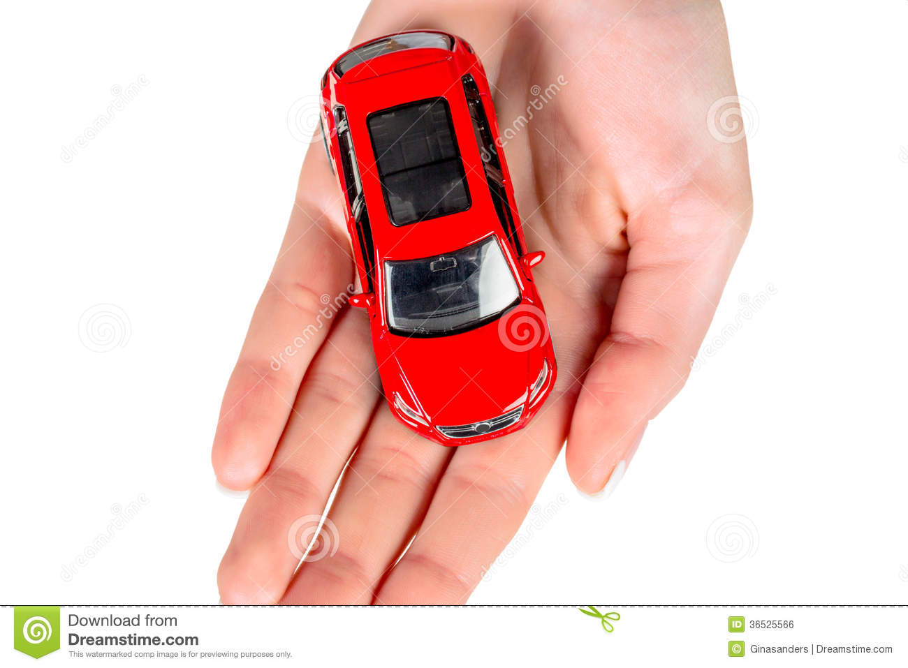 Hand holding model of a car