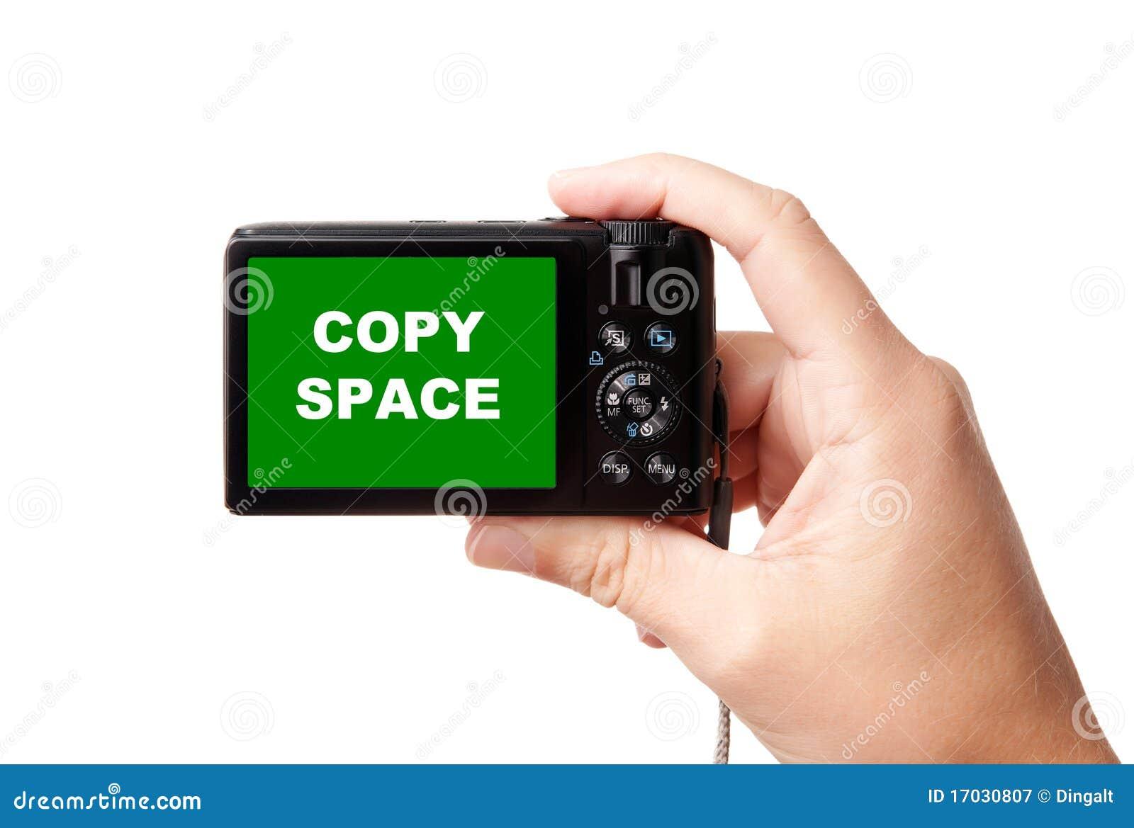 Hand holding modern digital camera
