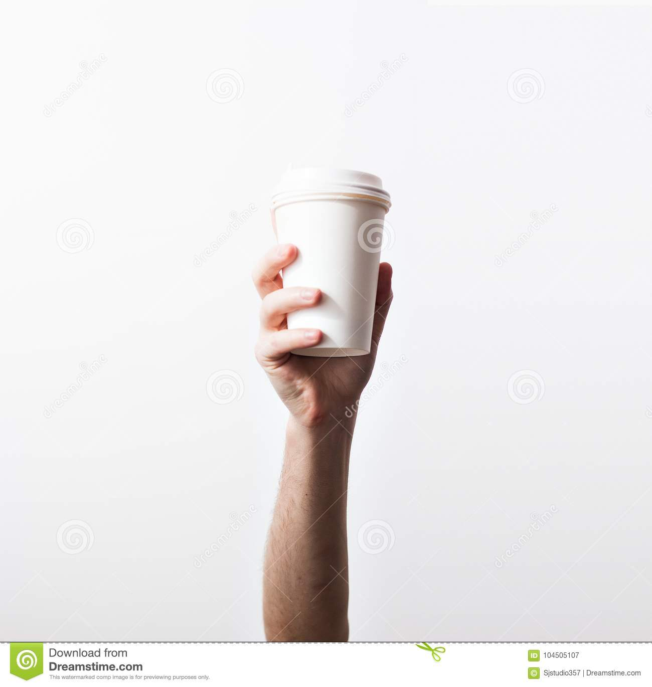 Hand holding a mug, Paper Coffee Cup with delicious coffee in a cafe on a white background, mock up, blank, your cafe shop desig