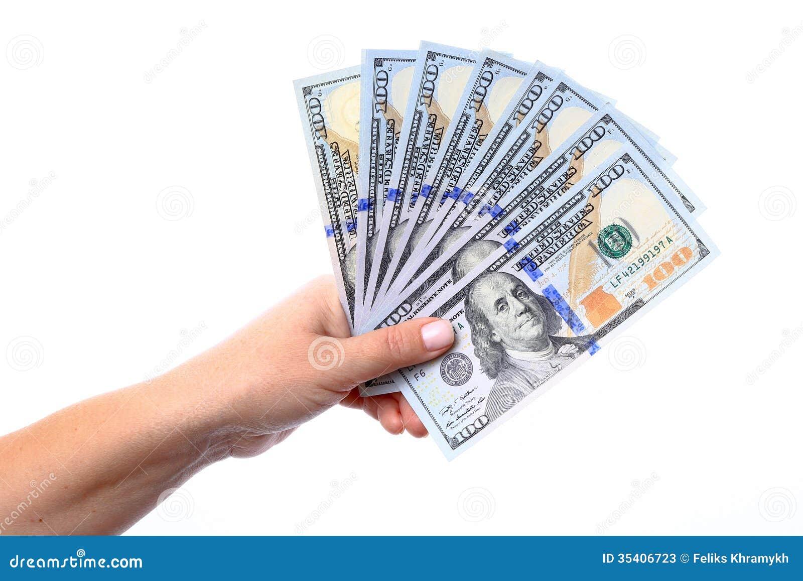 New Hundred Dollar Bills in Hand