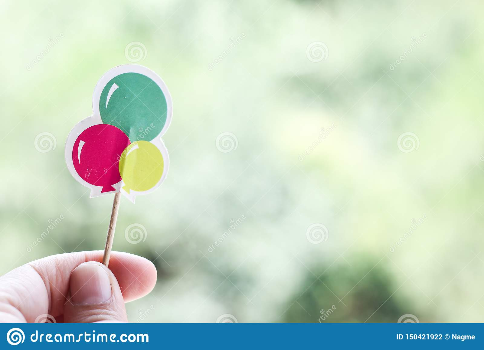 Hand holding paper balloons