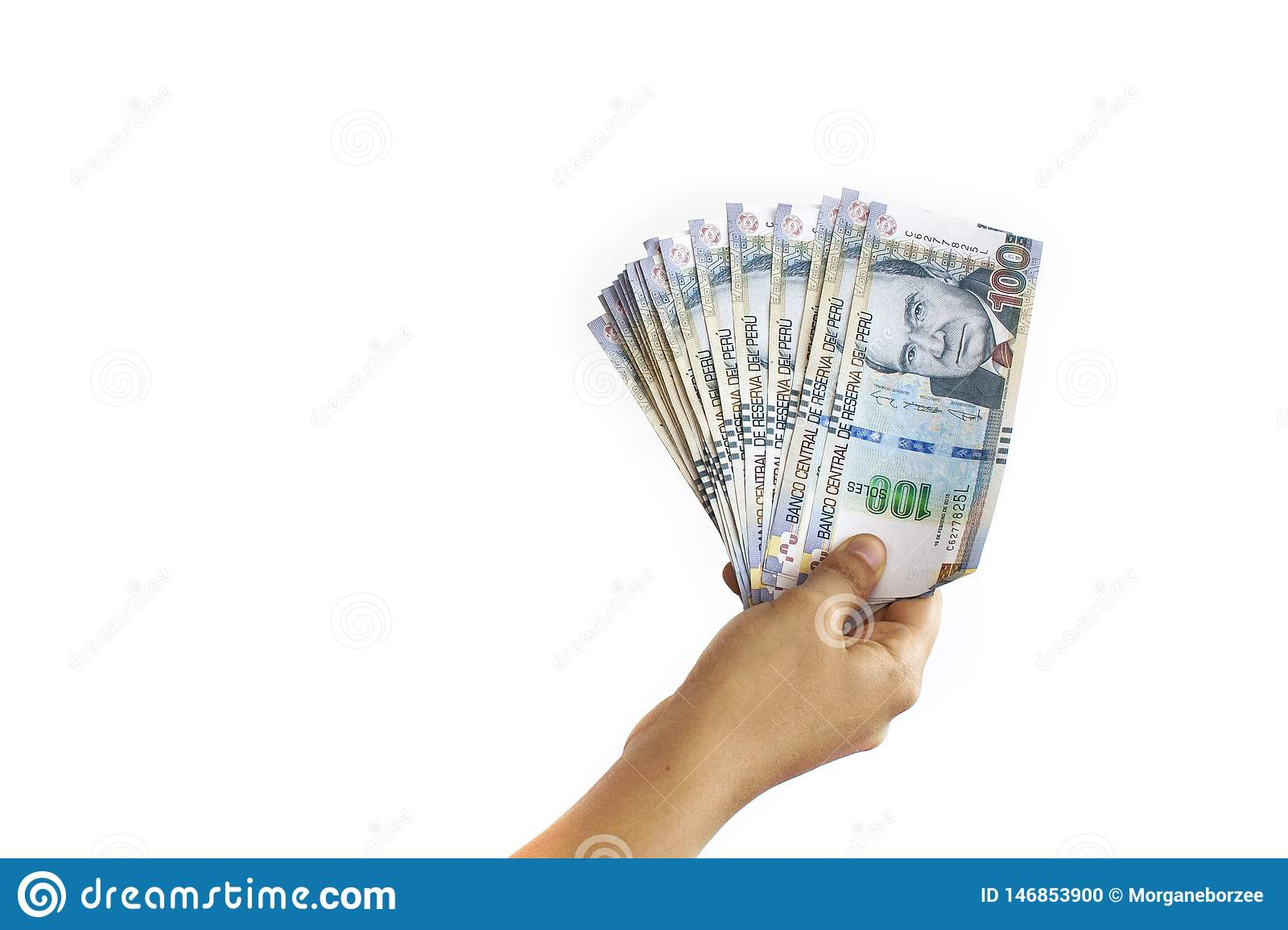 Hand holding Peruvian soles bills in a fan shape isolated