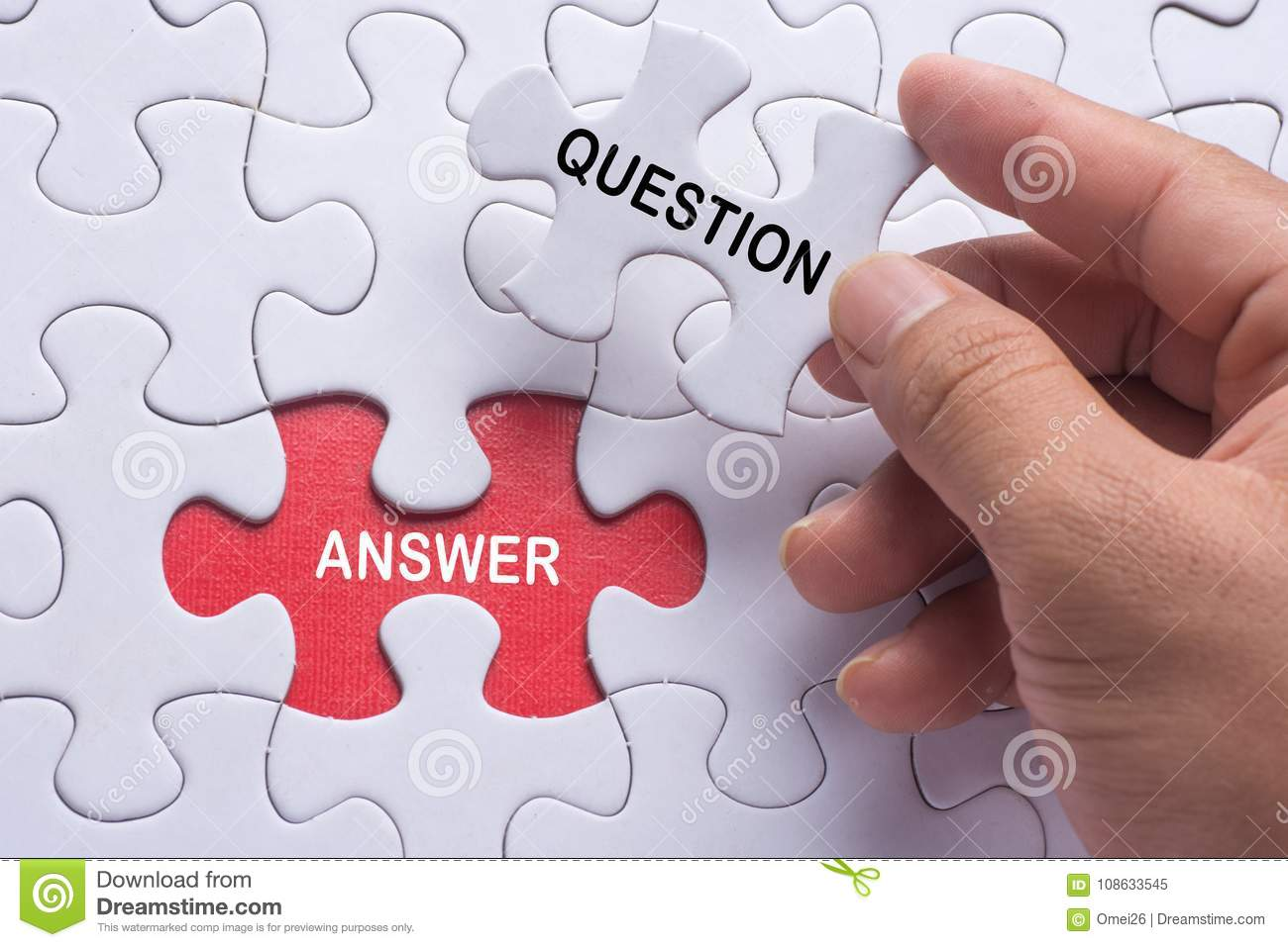 Hand Holding Piece Of Jigsaw Puzzle With Word Question ...