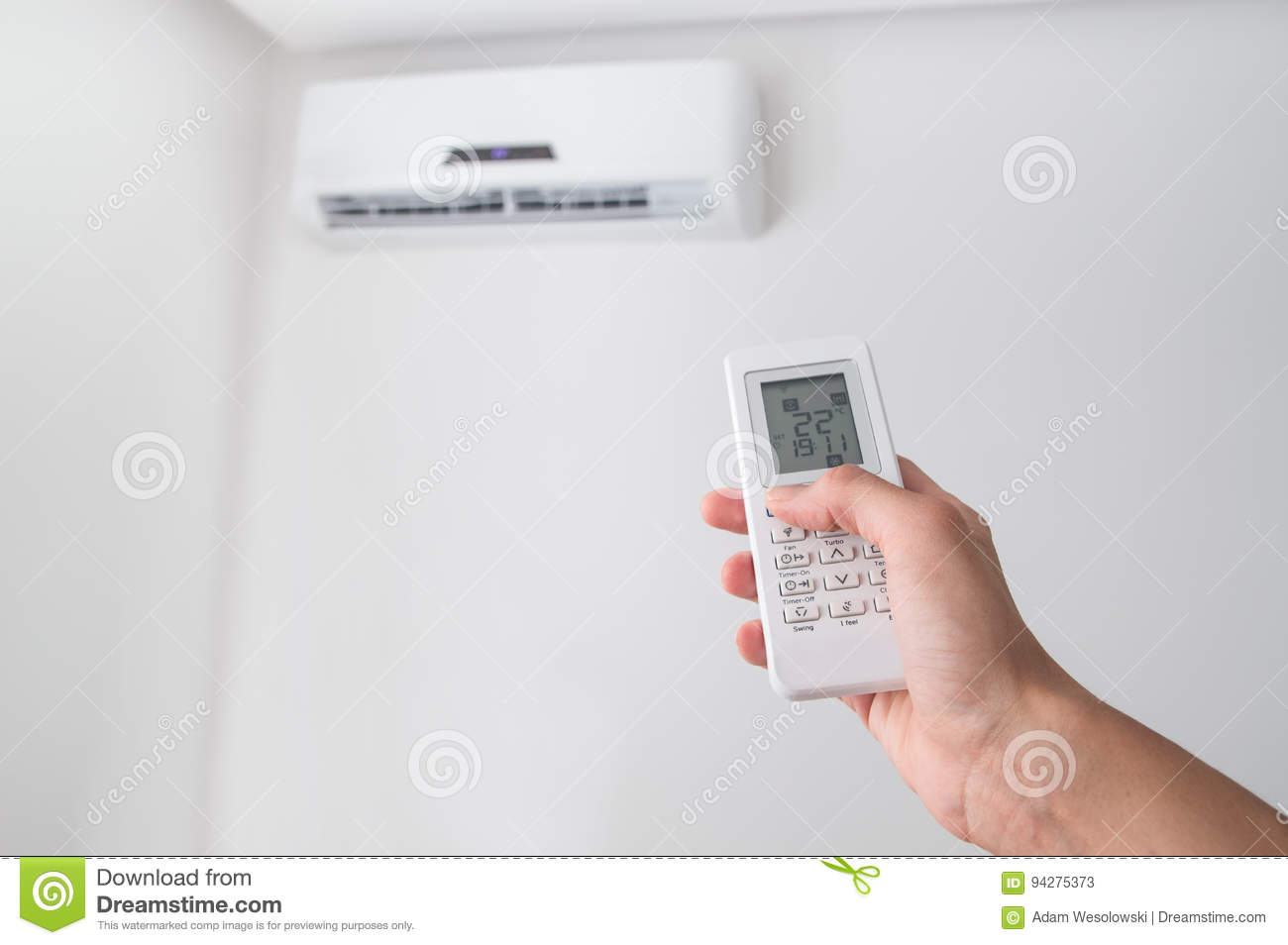 Girl Holding A Remote Control Air Conditioner Stock Photo