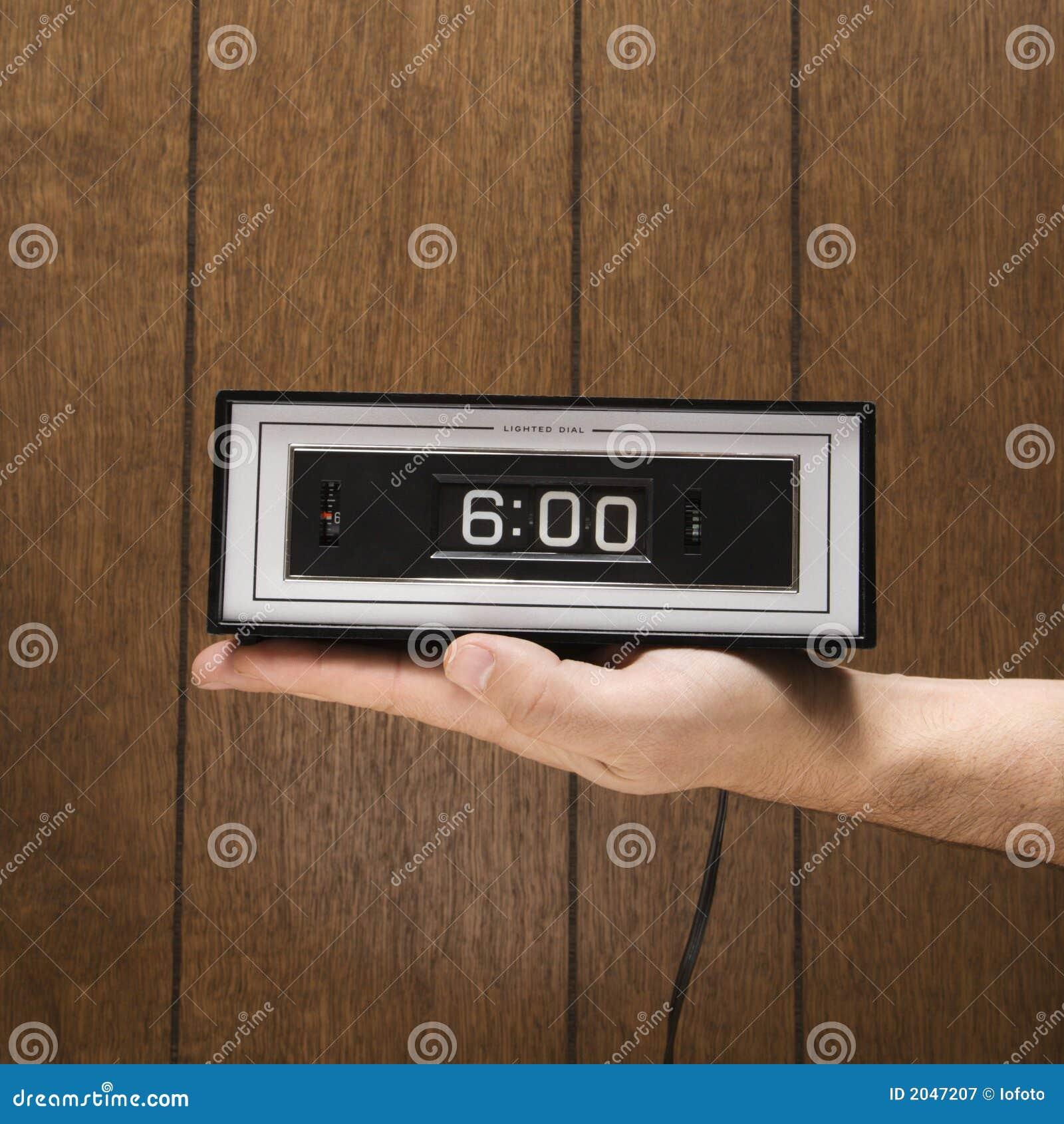 Hand holding retro clock set