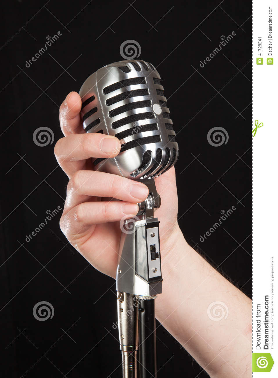 Microphone In Hand : Hand holding a retro microphone stock image of