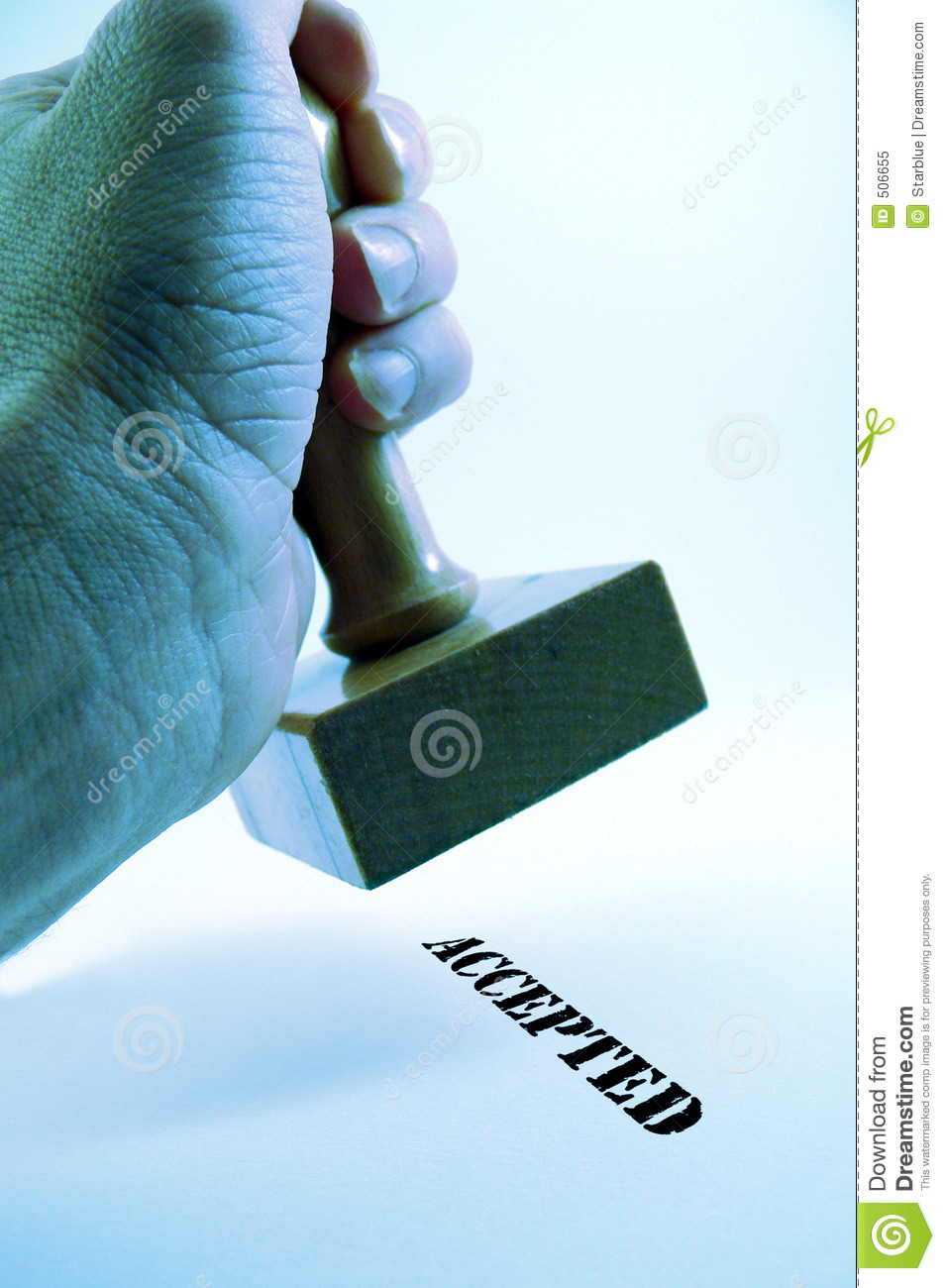 Hand holding rubber stamp - accepted