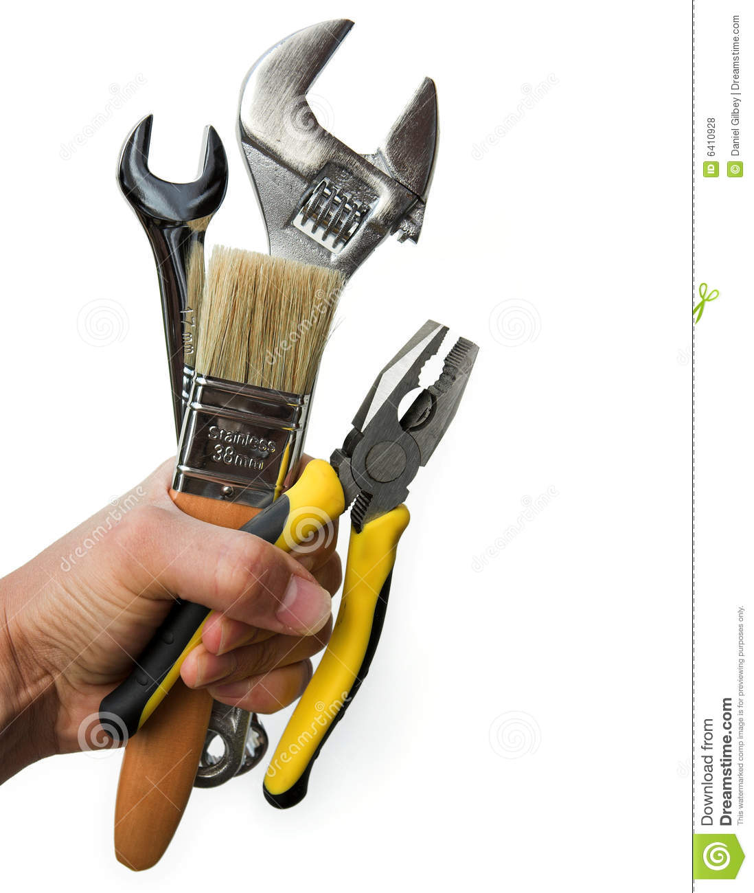 Hand holding a selection of tools