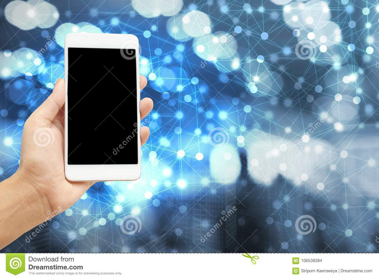 hand holding smart phone over modern abstract network and city background