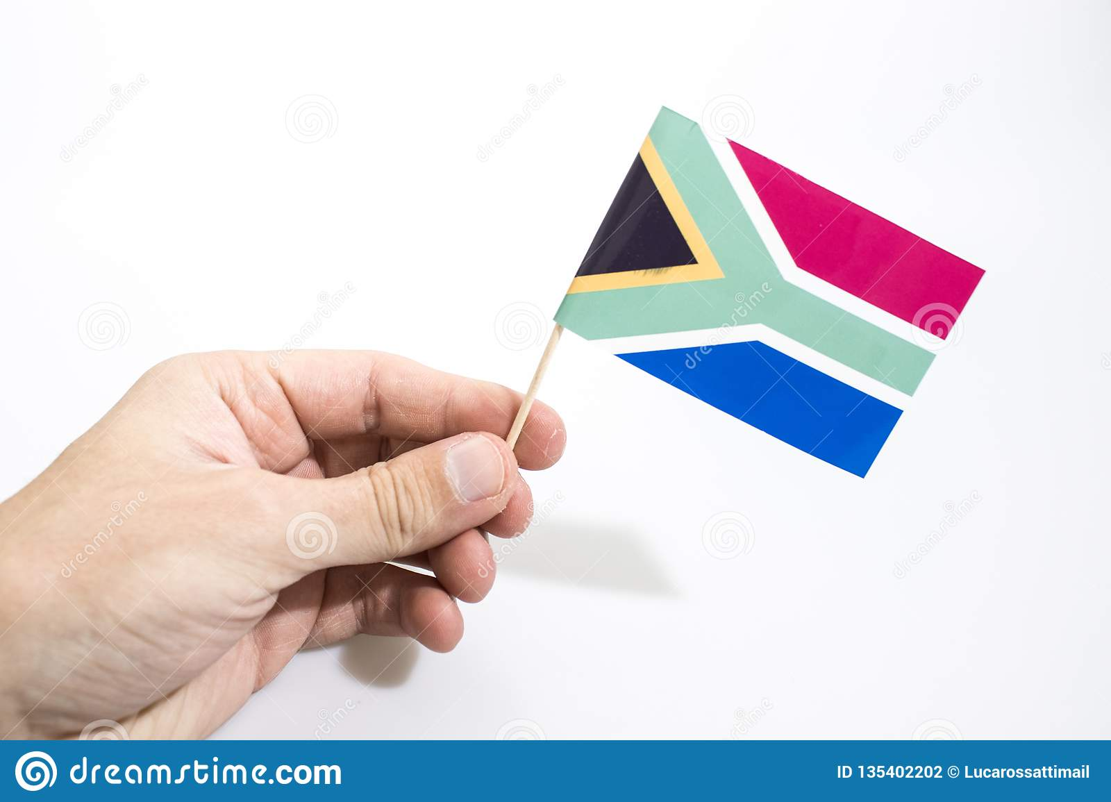 Hand is holding south africa flag isolated in a white background