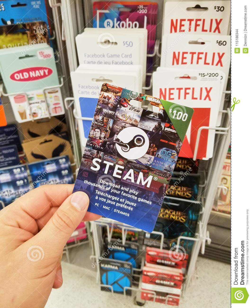 A Hand Holding A Steam Gift Card  Editorial Stock Image - Image of