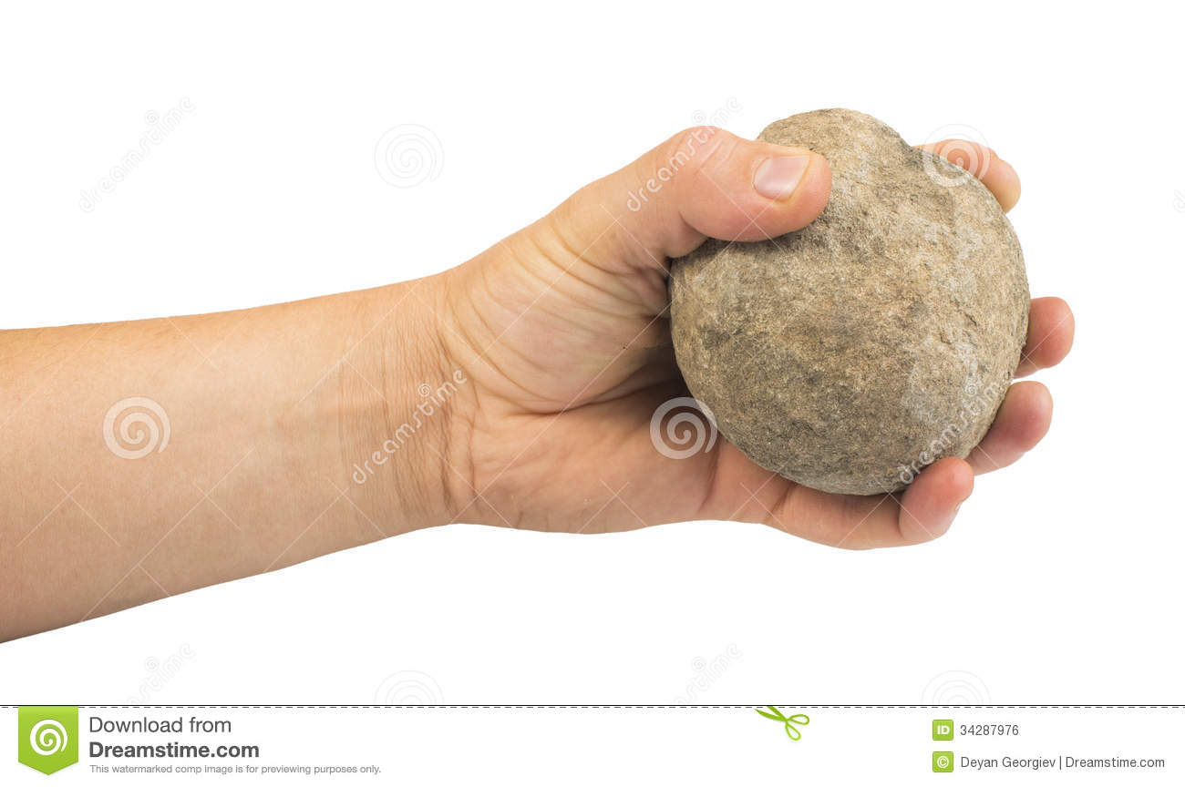 Hand Throwing Stone : Hand holding stone ball royalty free stock image