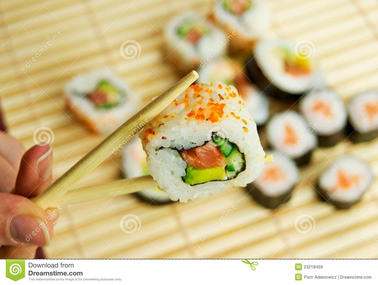 Hand holding sushi japanese traditional food stock image for Alaskan cuisine traditional